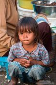 Travel photography:Small girl at the Battambang central market, Cambodia