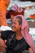 Travel photography:Man with Khmer head scarf at the Battambang central market people , Cambodia