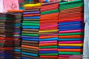 Travel photography:Scarfs for sale at the Battambang central market, Cambodia