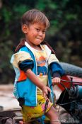 Travel photography:Small boy along the Stung Sangker river near Battambang, Cambodia