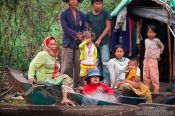 Travel photography:Family on their boat on the Stung Sangker river near Battambang, Cambodia