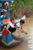 Travel photography:Boys fishing near the Tonle Sap Lake, Cambodia