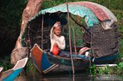 Travel photography:Boy on a boat near the Tonle Sap lake, Cambodia
