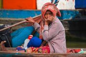 Travel photography:Woman near Tonle Sap lake, Cambodia