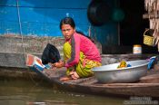Travel photography:Girl doing the dishes in the Stung Sangker river, Cambodia