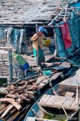 Travel photography:Woman on her floating house near Tonle Sap lake, Cambodia