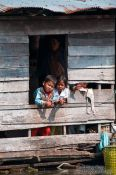 Travel photography:Kids in their floating home near Tonle Sap lake, Cambodia