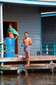 Travel photography:Having a wash near Tonle Sap lake, Cambodia