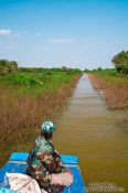Travel photography:Navigating through a narrow gap in the vegetation near Tonle Sap lake, Cambodia