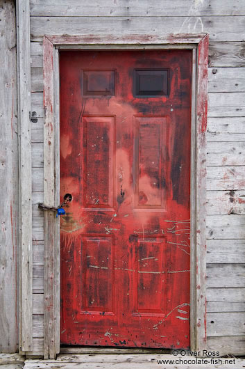 Red door of a shack in St. John´s harbour