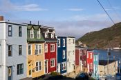 Travel photography:Row of wooden houses in St. John´s with harbour in the background, Canada