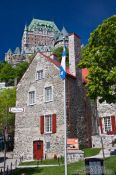 Travel photography:Old house in Quebec with Château Frontenac castle in the background, Canada
