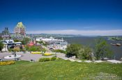 Travel photography:The Château Frontenac castle in Quebec with Terrasse Dufferin promenade and Saint Lawrence river, Canada