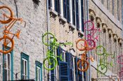 Travel photography:Bicycles on a facade in Quebec´s  lower old town (basse ville), Canada
