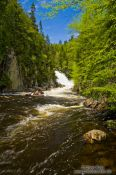 Travel photography:River in Quebec´s Mont Tremblant National Park with Chute du diable waterfall in the background, Canada