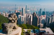 Travel photography:View of the Hong Kong skyline and bay with Chinese stone lion , China