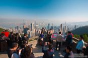 Travel photography:Tourists taking in the view of Hong Kong bay , China