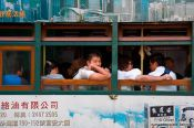 Travel photography:Passengers in a tram in downtown Hong Kong, China