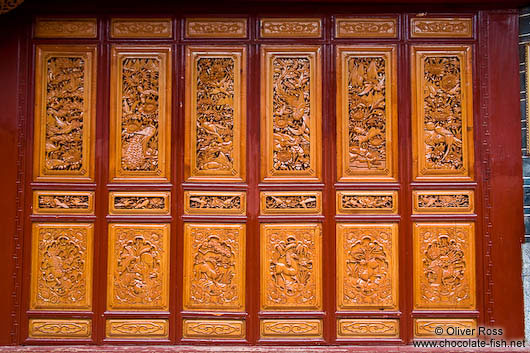 Ornately carved wooden doors in Lijiang