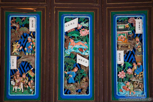 Ornately carved and painted window shutters at the Longevity Pavillion in Lijiang´s Black Dragon Pool park