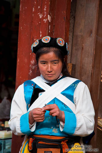 Girl with traditional Naxi dress in Lijiang