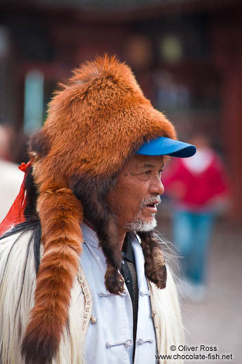 Man with fur hat in Lijiang