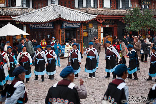 Group of Naxi women performing a traditional dance in Lijiang