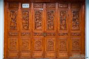 Travel photography:Ornate carvings on a wooden door in Dali, China