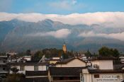 Travel photography:The golden Pagoda in Dali with mountains , China