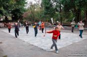 Travel photography:Morning sword practice gymnastics in Dali park, China