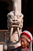 Travel photography:Yuantong temple guardian with Naxi woman in Kunming, China