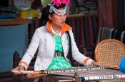 Travel photography:Girl with traditional Naxi dress weaving in Lijiang, China