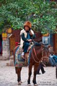 Travel photography:Lijiang man on horse, China