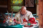 Travel photography:Lijiang man writing , China