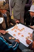 Travel photography:Lijiang men playing , China