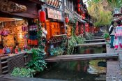 Travel photography:Channel with wooden bridges in Lijiang´s old town , China
