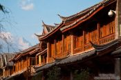 Travel photography:Lijiang traditional wooden houses with Jade Dragon Snow Mountain in the background, China