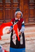 Travel photography:Naxi woman performing a traditional dance in Lijiang, China