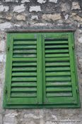 Travel photography:Green window shutters in Sibenik, Croatia