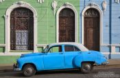 Travel photography:Cienfuegos houses with classic car, Cuba
