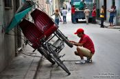 Travel photography:Repairing the cycle rickshaw in Havana, Cuba