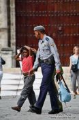 Travel photography:Boy with policeman in Old Havana, Cuba