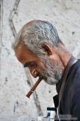 Travel photography:Man having a smoke in a public park in Havana, Cuba