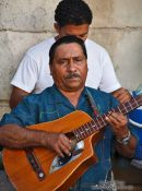 Travel photography:Guitar player in Havana Vieja, Cuba