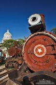 Travel photography:Old locomotive with the Capitolio in Havana, Cuba