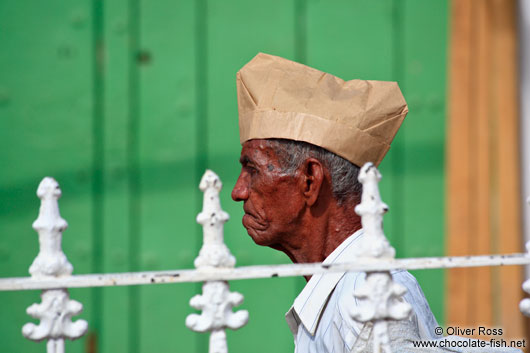 Man with paper hat in Trinidad