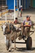 Travel photography:Man on horse carriage in Trinidad, Cuba