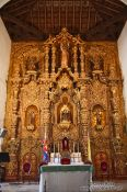Travel photography:The golden altar inside the Parroquia de San Juan Bautista de Remedios, Cuba