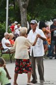 Travel photography:Elderly couple dancing in Santa Clara town square, Cuba