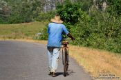 Travel photography:Man pushing his bike near Viñales, Cuba